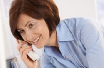 [Image of woman on telephone] Click the button below to get information on insurance and fees.