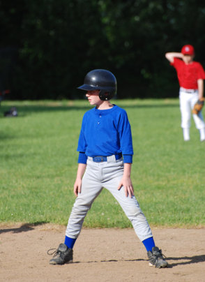 [Image of young boy in uniform playing baseball]  Use the button above to download a sports physical form