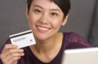 [Image of woman holding a credit card] Click the button below to go to the payment portal