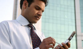[Image of man using smartphone] Click button below to read privacy policy