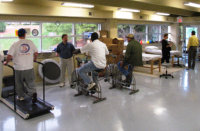 [Image of patients in physical therapy center] Click the button below for physical therapy information