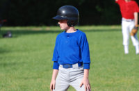 [Image of boy playing in a baseball game] Click the button below for sports physicals information