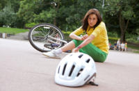 [Image of woman injured from bicycle accident] Click the button below for urgent care information