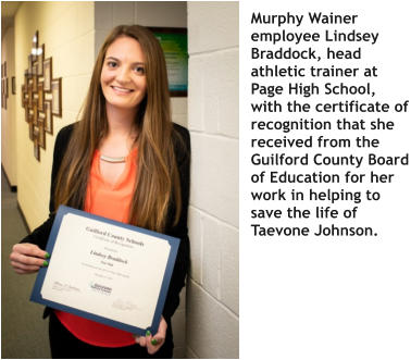 Murphy Wainer employee Lindsey Braddock, head athletic trainer at Page High School, with the certificate of recognition that she received from the Guilford County Board of Education for her work in helping to save the life of Taevone Johnson.
