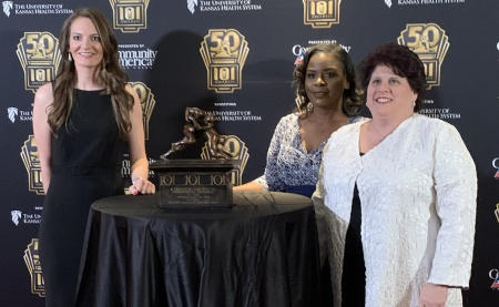 Murphy Wainer athletic trainer Lindsey Braddock (left) is shown at the 101 Awards in Kansas City, MO, with Tamesha Logan and Marisa Brunett, representatives of the National Athletic Trainers' Association, which nominated Braddock for recognition at the ev